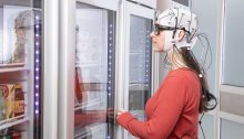 Mobile EEG & eye tracking Fig.1. Out-of-the-lab and ecologically valid scenario. A participant is standing in front of a fridge and is about to pick up something to eat. EEG and eye tracking are simultaneously recorded to study the participant's natural behavior.